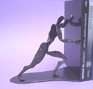 contemporay metal bookends with a pushing figure