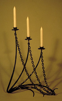 sculptural candlestick with chains