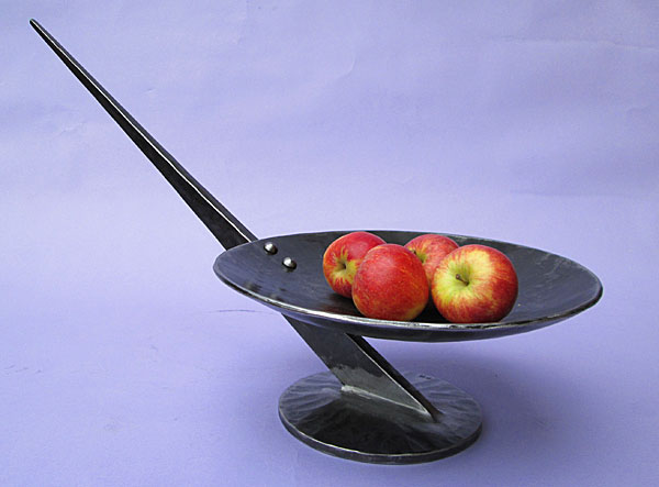 fruit bowl in metal, a stylish piece of contemporay sculpture