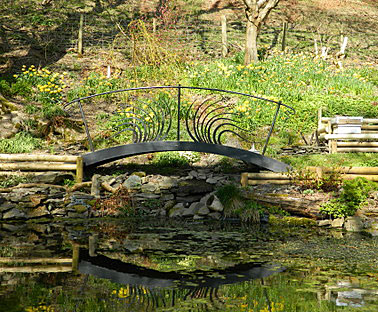 decorative metal bridge for a garden pool