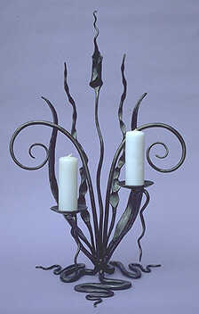 candlestick with an organic theme, a candleholder with a floral design