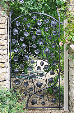 metal garden gate with grapevine theme in wrought iron
