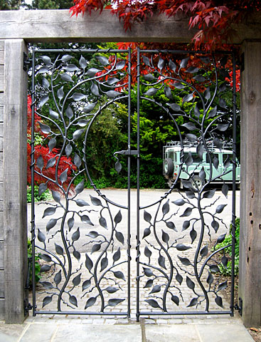 pair of garden gates in forged metal and wrought iron