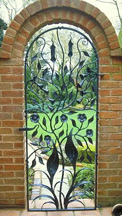 garden gate in forged metal with a decorative floral artistic design